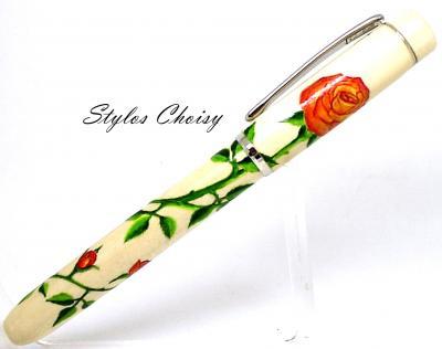 Plume collection Empreinte aux roses orangées sur houx et platine