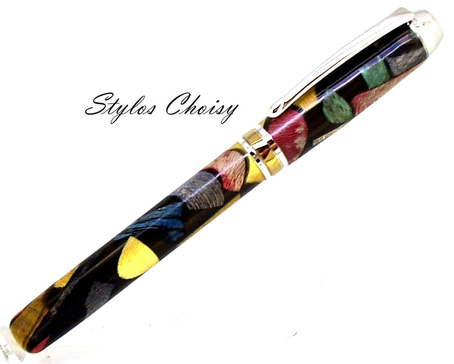 Plume serenite inclusion bois precieux dans resine noire platine et titanium 2